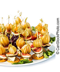 Canapes with physalis, fig, cheese crackers