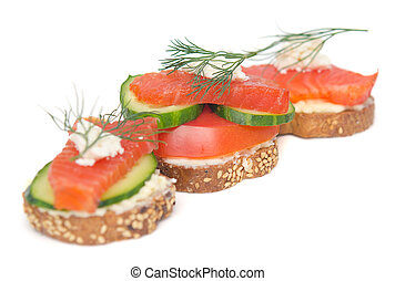 canapes with red fish on white background