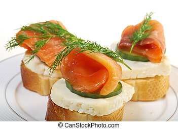Canapes with smoked salmon  cheese and cucumber