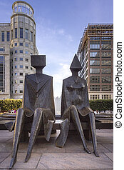 Canary wharf riverside inland bay plaza statues, London,...