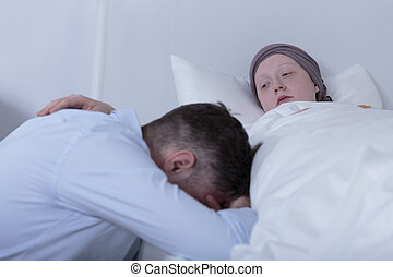 Cancer child comforting despair father - Image of cancer...
