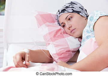 Cancer girl lying in hospital