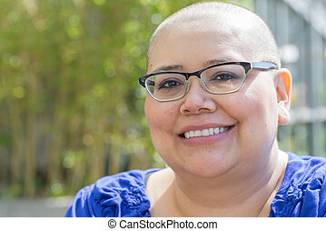 Cancer Patient Deals With Hair Loss - Hispanic woman with...