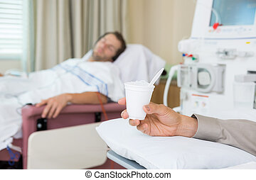 Cancer Patient Holding Glass Of Crushed Ice - Male cancer...