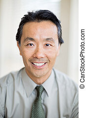 Cancer Specialist Doctor Smiling In Hospital - Portrait of...
