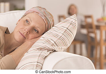 Cancer woman lying on couch