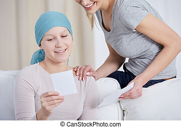 Cancer woman watching photos