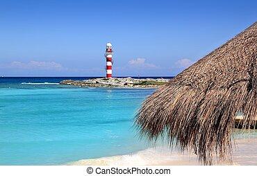 Cancun lighthouse turquoise caribbean beach
