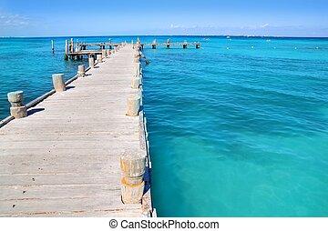 Cancun wood pier in  tropical Caribbean sea