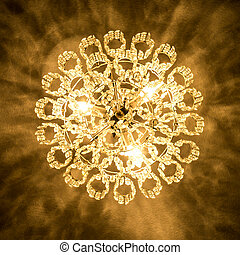 candelabra - an old candelabra hanging from a ceiling