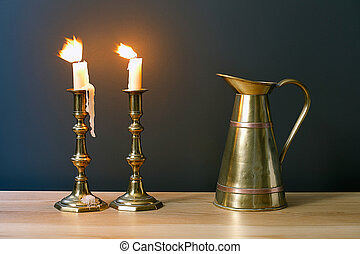 Candelabra With Burning Candles And Antique Jar In Interior