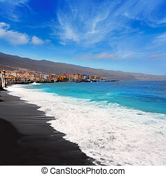 Candelaria black sand beach in Tenerife at Canary Islands