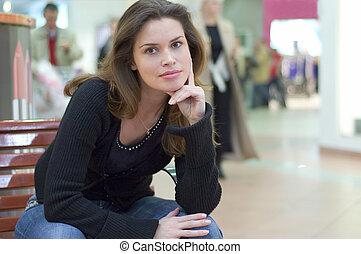 Candid casual portrait in a city mall - Pretty brunette in...
