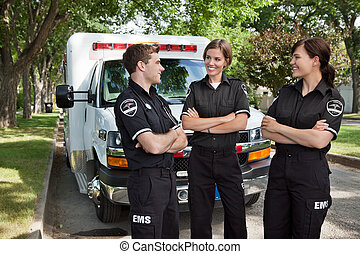 Candid EMS Professionals - Group of 3 EMS workers standing...