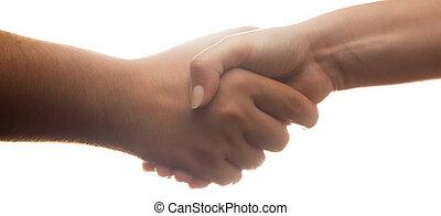 Candid handshake on white background. Strong backlight. Banner proportion.