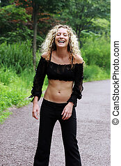 Candid laughter - Portrait of a gorgeous woman in sexy black...