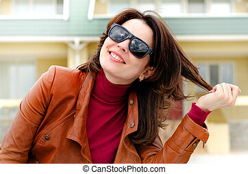 Candid Photo of a Woman in Shades on a sunny day.