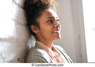 Candid portrait of a smiling young woman - Close up candid...