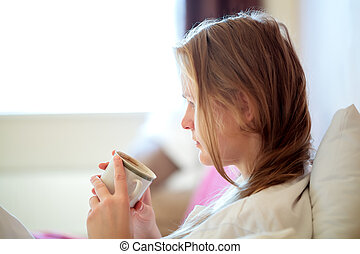 Candid portrait of a woman drinking coffee