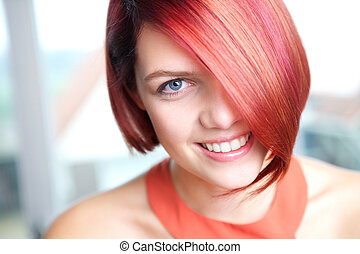Candid portrait of a young woman smiling