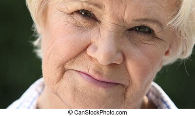 Candid smile - Macro shot of a retired woman with a candid...