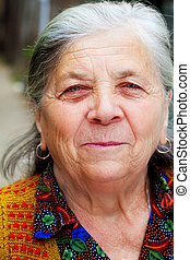 Candid smile of one happy senior woman - Candid portrait of...