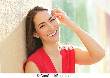 Candid woman in red with perfect smile looking at camera