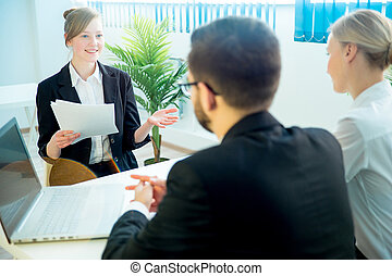 Candidate explaining something - A young woman candidate is...