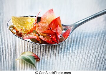 rose petals - Candied rose petals on spoon