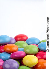 Candies against a white background - brightly colour candies...