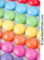 Candies multi coloured against a white background