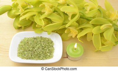 Candle and pebbles with orchid - Green tin candle and...