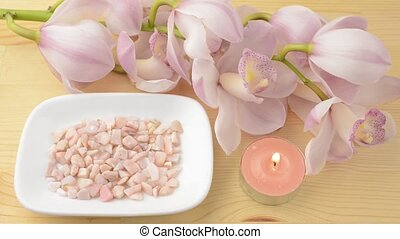 Candle and pebbles with orchid - Pink tin candle and pink...