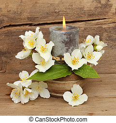 Candle and philadelphus flowers - Burning Feng Shui candle...