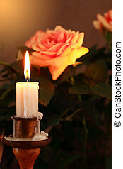 Candle And Rose - Closeup of lighting candle on dark...