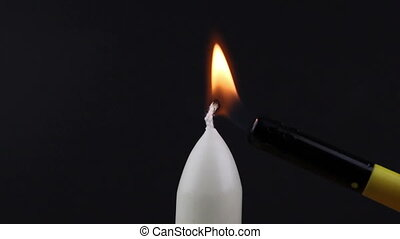 Candle being lit with a lighter