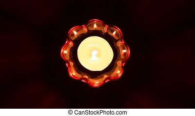 Candle burning in glass candlestick