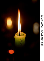 Candle burning in the dark.