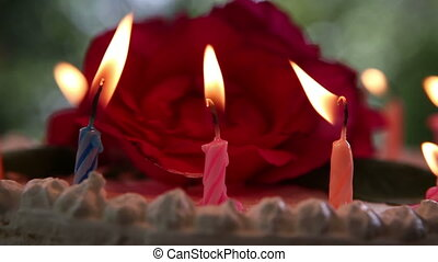 candle burning on a birthday cake