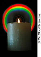 The candlelight when reflected on a CD's burned surface creates rainbow colors at a certain angle (shallow DOF, focus on candle)