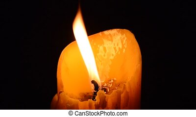 candle fire in the dark night and wind blowing light off