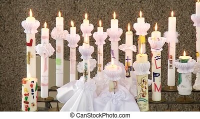 video footage of candles for the first communion in a church
