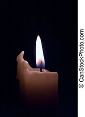 candle flame - flame of a candle on a black background
