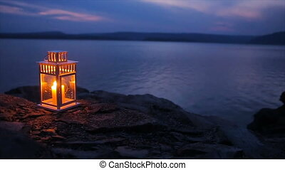 candle flame shines on the lake - candlestick on the lake in...