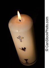Candle for christianity burning on black background