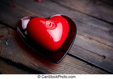Candle heart - Image of red heart shaped candle on wooden...