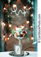 candle holder with a  and  bouquet of roses