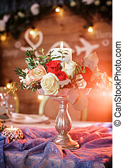 candle holder with a  and  bouquet of roses for the weddi