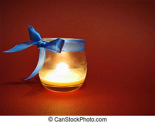 Candle in glass bottle