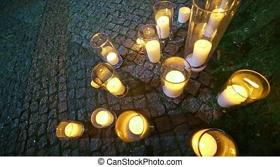 Candle in Glass Vase on the ground